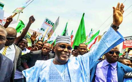 Nigerias opposition leader Atiku signs elections peace pact