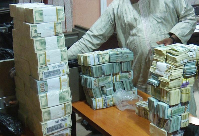 Stacks-of-Cash-Totaling-9.7M-Found-in-Nigerian-Raid