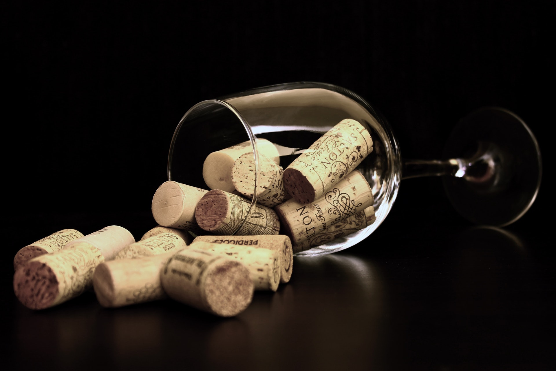 brown-corks-on-clear-wine-glass-36741